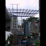 Unfinished new trellis system on a gloomy day.